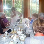 Harriet Serves Tea to Her Guests