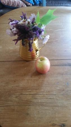 An Apple for the Teacher and Flowers.